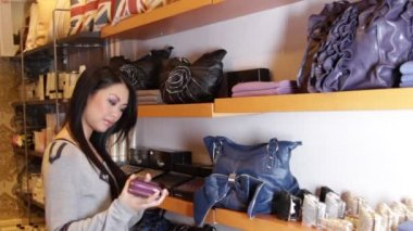 Female looking at handbags — Stock Video