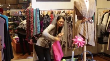 Female in clothes shop — Stok video