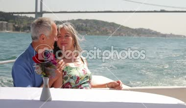 Senior couple embracing on a yacht — Stock Video