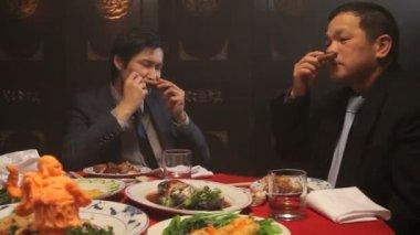 Businessmen toasting drinks and smoking — Stock Video