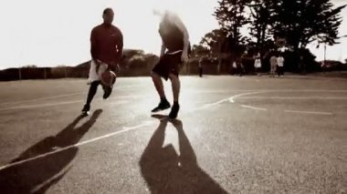 Male basketball players dribbling — Stock Video
