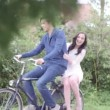 Couple riding on bicycle — Stock Video #67048875