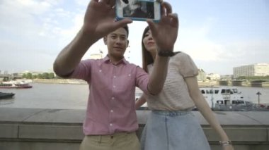 Young couple taking self-portrait — Stock Video