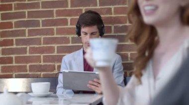 Man listening music through tablet — Stock Video