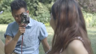 Man photographing woman — Stock Video