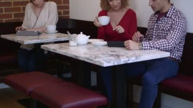 Man and women sitting in cafe — Stock Video