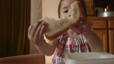 Girl showing bread — Stock Video
