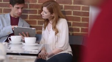 Couple sitting in cafe — Stock Video