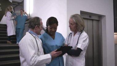 Doctors and nurse using digital tablet — Stock Video