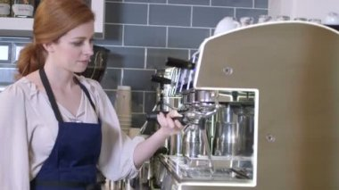 Woman using coffee maker — Stock Video