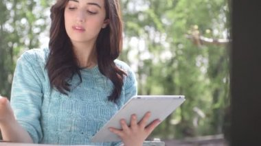Woman using digital tablet — Stock Video