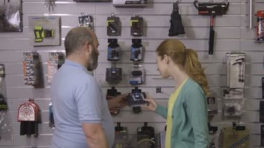 Man and woman in shop — Stock Video