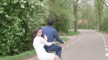 Couple riding on bicycle — Stock Video