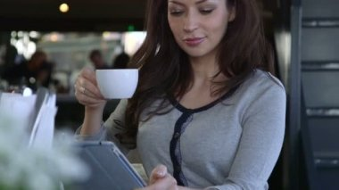 Young woman using digital tablet — Stock Video
