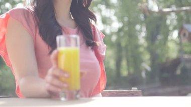 Woman drinking juice — Stock Video