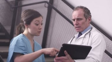 Doctor and nurse using digital tablet — Stock Video