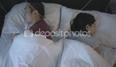 Couple sleeping on bed — Wideo stockowe