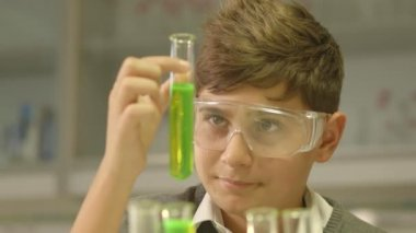 Boy watching at test tube — Stock Video
