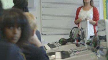 Music teacher teaching children — Stock Video