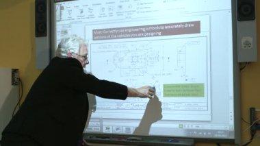 Professor using computer — Stockvideo