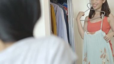 Woman trying clothes — Stock Video