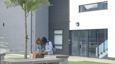 Schoolgirls using digital tablet — Stock Video