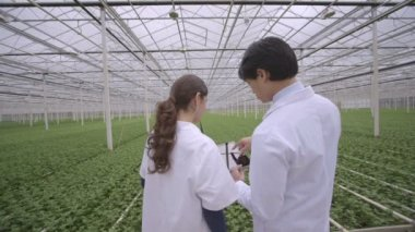 Scientists using digital tablet — Stock Video