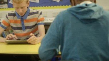 Schoolboys using digital tablet — Vídeo de stock