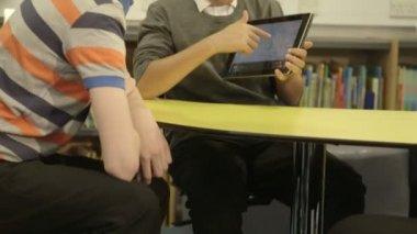 Schoolboys using digital tablet — Stock Video