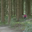 Woman cycling in forest — Stock Video #67365061