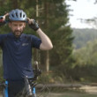 Man getting ready for cycling — Stock Video #67366541