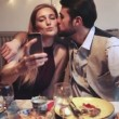 Woman taking selfie while man kissing her — Stock Video #67367903