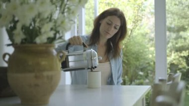 Woman pouring coffee in cup and drinking — Stock Video