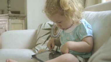 Girl playing with digital tablet — Stock Video