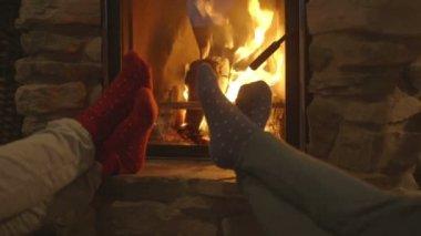 Women relaxing beside fireplace — Стоковое видео