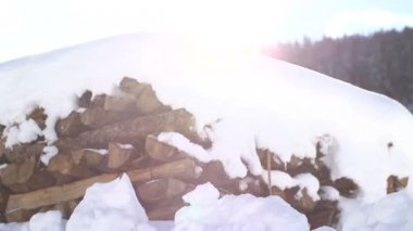 Snow covered firewood stack — Stock Video