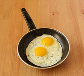 Sunny side up eggs in a saucepan — Stock Photo