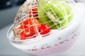 Dessert ice-cream with a strawberry and kiwi — Stock Photo