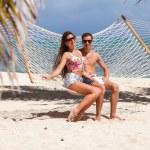 Romantic Couple Relaxing In Beach Hammock — Stock Photo #73922789