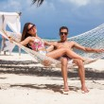 Romantic Couple Relaxing In Beach Hammock — Stock Photo #73922859