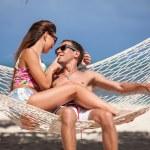 Romantic Couple Relaxing In Beach Hammock — Stock Photo #73922901