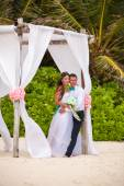Young loving couple wedding in gazebo. — Stock Photo