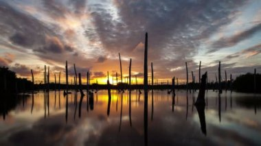 Apocalyptic dramatic clouds and sunset over lake, time-lapse — Stock video
