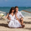 Romantic Couple Relaxing In Beach Hammock — Stockfoto #75818687