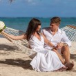 Romantic Couple Relaxing In Beach Hammock — Stock Photo #75818947