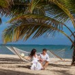 Romantic Couple Relaxing In Beach Hammock — Stock Photo #75818959