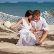 Romantic Couple Relaxing In Beach Hammock — Stock Photo #75819035