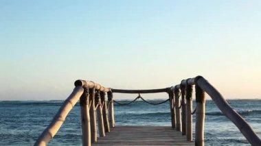 Wood bridge on the beach near the ocean. — Stock Video
