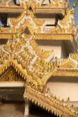 Myanmar art on Maha Muni Pagoda. — Photo