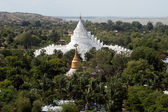 The view from the top of the pagoda looks out on Mya Theindan pagoda,Myanmar. — Stock Photo